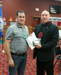 Sokaogon Chippewa Vice Chairman Arlyn Ackley, Jr presents LCO Chairman Mic Isham with a Mole Lake tribal flag on behalf of Skaogon Chairman Chris McGeshick.